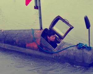 Китайський фермер зробив підводний човен Поштівка